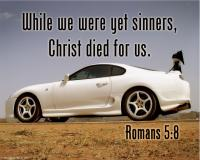 View the image: White sports car, Romans 5:8
